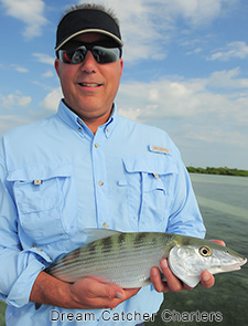 Angler holds up a nice bonefish caught in Key West with Dream Catcher charters.